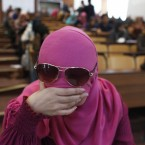 A Libyan student completes her final exam in a health course at university in Tripoli (AP Photo/Tara Todras-Whitehill)