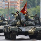 Belarusian army tanks drive during today's parade in Minsk marking Independence Day. (AP Photo/Sergei Grits)