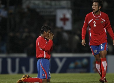 Costa Rica's Pedro Leal, left, prays at the end of last night's win.