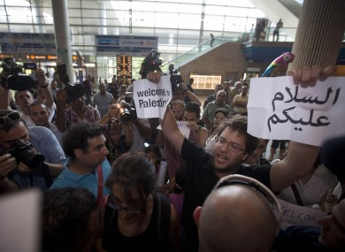 Protesters gather to welcome 'flytilla' members at Ben Gurion airport on Friday
