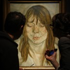 Visitors look at Lucian Freud's work entitled 'Woman Smiling' during a photo call at Christie's in London.