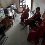 Young Buddhist monks play a virtual game of football at a video game parlor in Katmandu, Nepal. (AP Photo/Niranjan Shrestha)