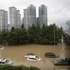 Vehicles are submerged in floodwater after heavy rain in Seoul, South Korea. (AP Photo/Ahn Young-joon)