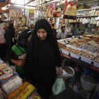 A woman shops for food in preparation for the Muslim fasting month of Ramadan, in Baghdad, Iraq. (AP Photo/ Karim Kadim)