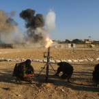 Palestinian Islamic Jihad fighters train at the Nusseirat refugee camp in central Gaza Strip. (AP Photo / Ashraf Amra)