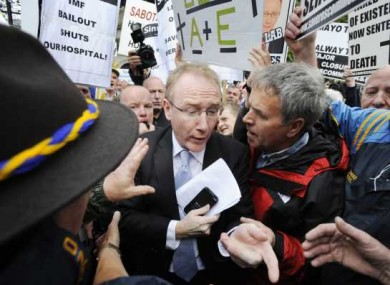 Frank Feighan TD is challenged by protestors against the Roscommon hospital A&E downgrade outside the Dail yesterday