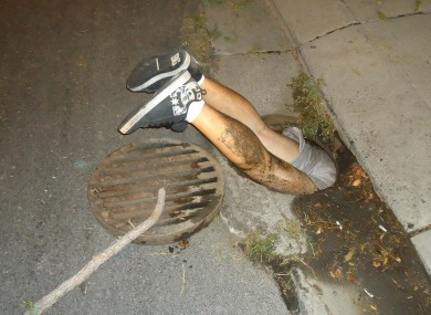 Mr Medeiros in the manhole