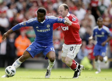 Mikel in action against Wayne Rooney