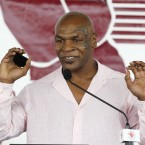 Mike Tyson was arrested following an airport scuffle with a photographer on 11 November 2009.