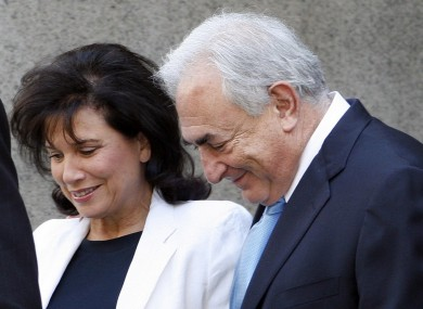 Dominique Strauss-Kahn leaves New York State Supreme court with his wife Anne Sinclair in July. At least some of the charges against him are expected to be dropped tomorrow.