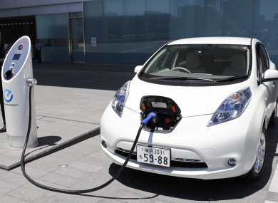 Nissan's chief engineer Hidetoshi Kadota demonstrates how a Nissan Leaf electric car is recharged. The manufacturer has accused Top Gear of deliberately trying to make its car run out of power.