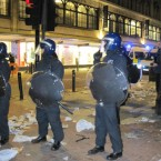 Police in riot gear outside Debenhams in Clapham Junction, south London, last night. (Neil Lancefield/PA Wire)