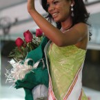 Inmate Raira Paixao waves to the crowd after being elected as Miss Penitentiary 2011. (AP Photo/Eraldo Peres)