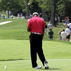 Tiger Woods bows his head in frustration as another shot sails wide of the target during the first round of the 93rd USPGA Championship. He would later sign for 77, the worst opening round of his major championship career.