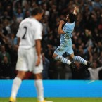 Sergio Aguero came off the bench to score twice on his debut for Manchester City against Premier League newcomers Swansea on Monday night. 