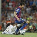 From one debut to another, as Barcelona's Cesc Fabregas crumbles under a two-footed challene from Real Madrid's Marcelo. The 