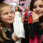Daisy, 5, and Millie Robinson, 9, from Suffolk with the figurines (Lewis Whyld/PA Wire)