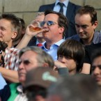 British Prime Minister David Cameron enjoys a pint during the Fourth Test between England and India at The Oval cricket ground in London.