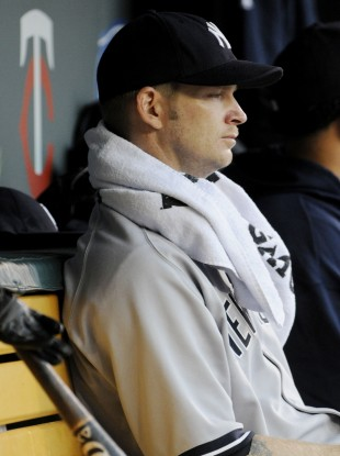  A.J. Burnett, takes in the rest of the second inning from the dugout. 