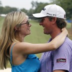 Webb Simpson embraces his wife after winning the Wyndham Championship in North Carolina. It was the 26-year-old's first Tour victory.