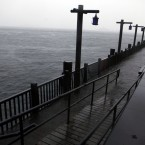 Rising water covers part of a walkway in Battery Park City's South Cove as Hurricane Irene approaches New York (AP Photo/Jason DeCrow)