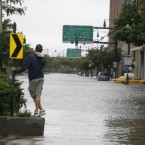 A man surveys the deep water on Manhattan''s West Side (AP Photo/Peter Morgan)