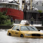 A New York City taxi is stranded in deep water on Manhattan'€™s West Side as Irene passes through the city (AP Photo/Peter Morgan)