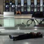 People sleep at Penn Station in New York, early Sunday. Public transportation in New York shut down around noon on Saturday. (AP Photo/Chelsea Matiash)