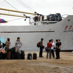 Chinese travel agents prepare to board the North Korean leisure boat