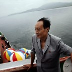 A North Korean man stands on the deck of the North Korean leisure boat the
