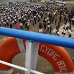 North Koreans gather to send off the North Korean leisure boat the