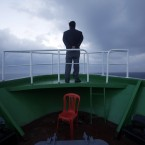 A man stands on the bow of the North Korean leisure boat the