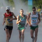 Ireland's Michael Doyle (C) passes a cooling station while competing in the men's 20km walk at the World University Games in Shenzhen, China. He eventually finished on 19th place.