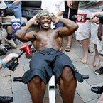 Terrell Owens shows off doing some sit-ups.