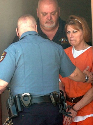 Nanette Craver is led to the courtroom for her preliminary hearing in Dillsburg, Pa. on Thursday, April 29, 2010