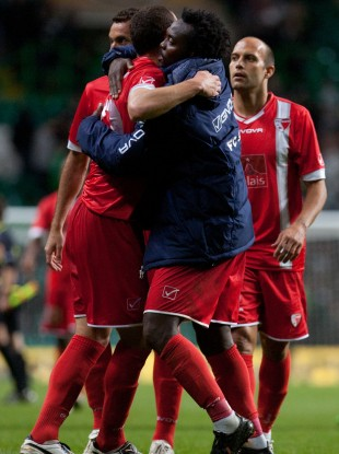 FC Sion players celebrate their result over Celtic