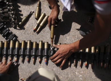 Libyan rebels prepare ammunition between Tarhouna and Bani Walid yesterday.