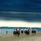 Horses and jockeys go to post at Laytown.