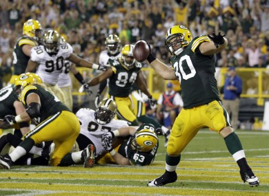 Green Bay Packers' John Kuhn celebrates after rushing for a touchdown.