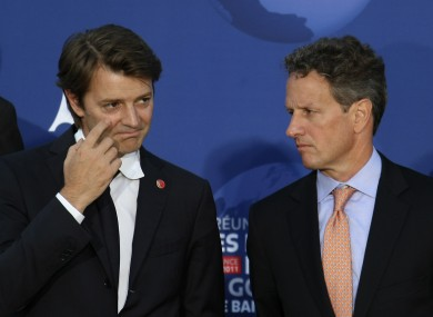 Geithner, right, with French finance minister Francois Baroin last week