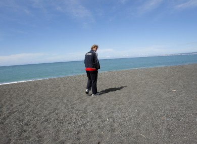 French rugby player Aurelien Rougerie walks along the beach in Napier.