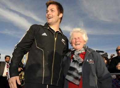 All Blacks captain Richie McCaw poses for a photograph with 73-year-old old Trish Conner in Christchurch