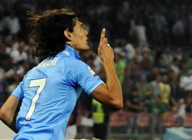 Napoli's Edison Cavani  celebrates scoring against Milan.