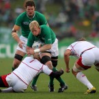 Ireland's Leo Cullen is tackled by Russia's Sergey Popov.
