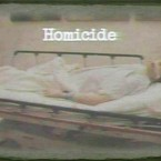 A photograph displayed to jurors in Los Angeles shows Michael Jackson after his death. The word 'Homicide' has been added by the prosecution. (AP)