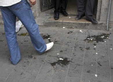 Eggs lie on the ground after being thrown at US ambassador Robert Ford by supporters of Syrian president Bashar Assad.