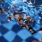 A young Dublin supporter waits for the team's arrival.