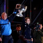 Dublin manager Pat Gilroy and captain Bryan Cullen carry the Sam Maguire out onto the stage.