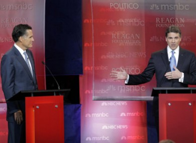Texas Governor Rick Perry and Massachusetts Governor Mitt Romney in a presidential candidate debate last week.