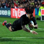 Ma'a Nonu dives over to score during New Zealand's 11-try rout of Japan.